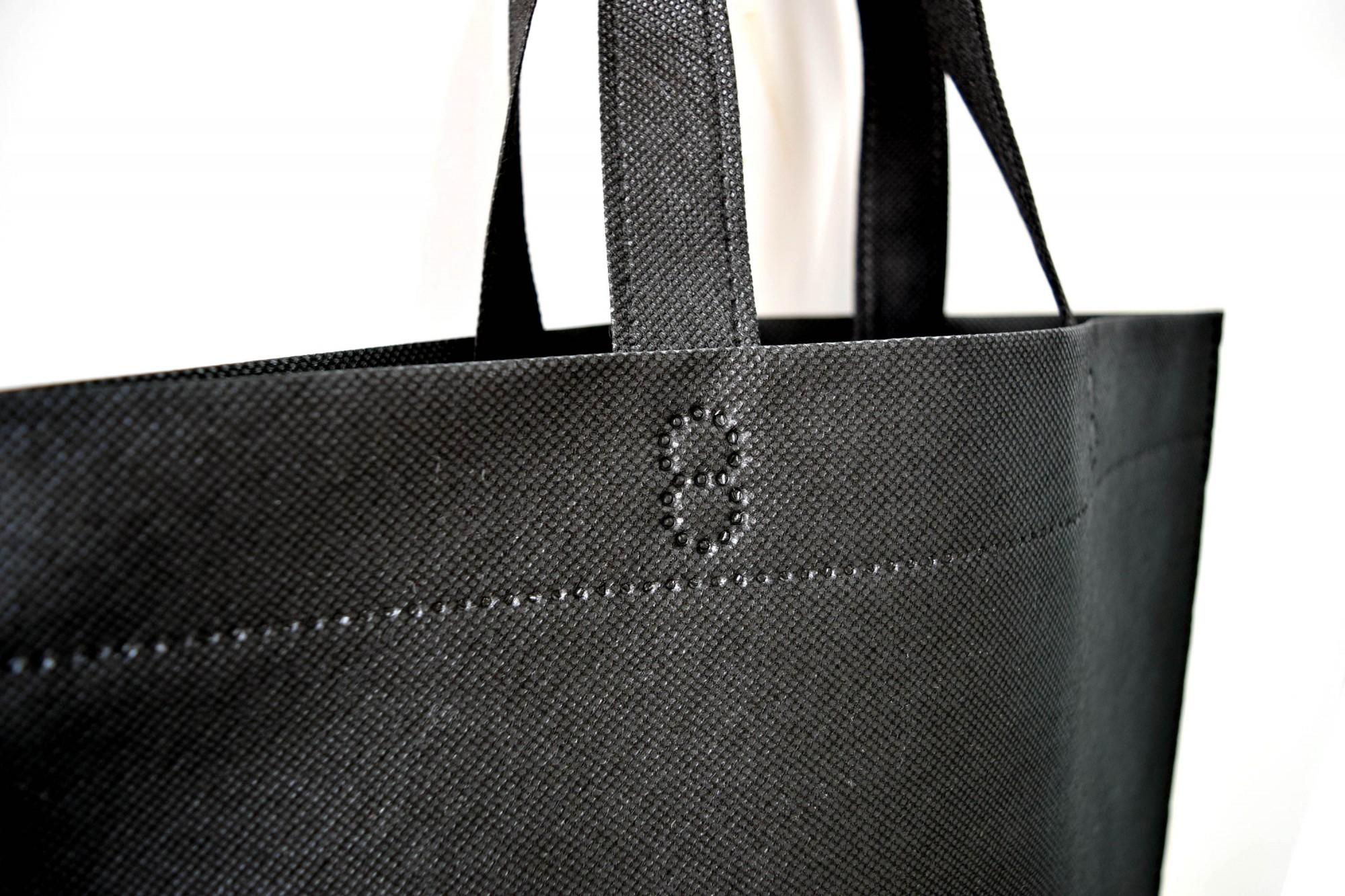 ハウスメーカー開催のモデルハウス・イベント用。低価格の超音波縫製のA3不織布バッグ。持ち手部分。