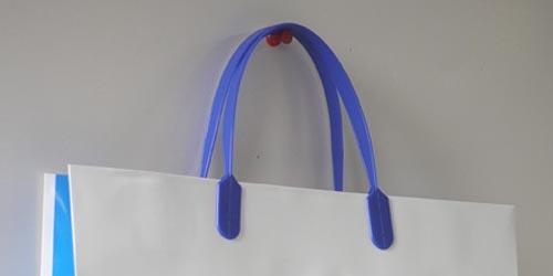 資料の配布や持ち運び用の、グロスPP加工の手提げ紙袋(大サイズ)