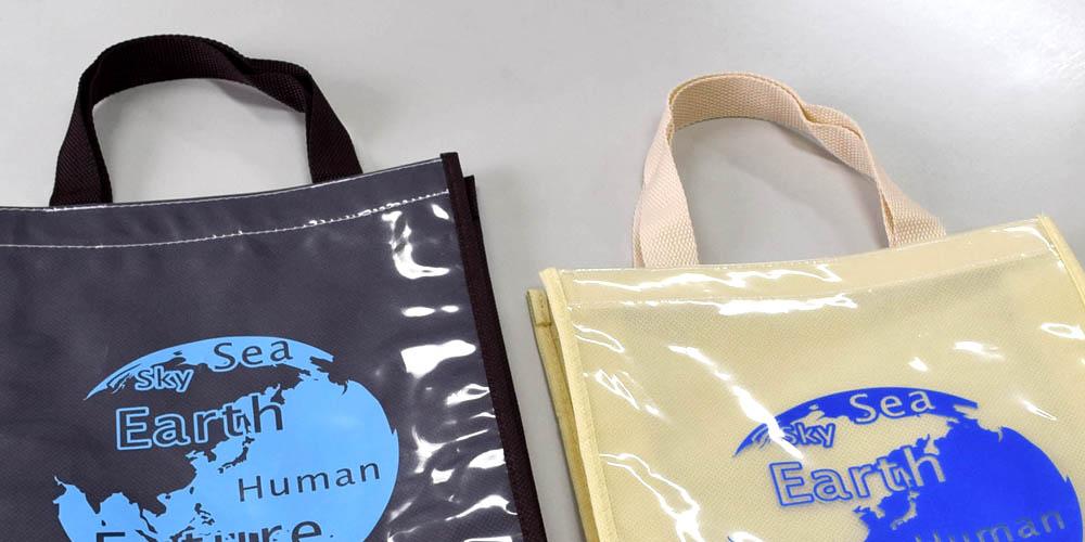学会セミナー・講演会、イベント等での資料配布用 透明PE+不織布の2層バッグ