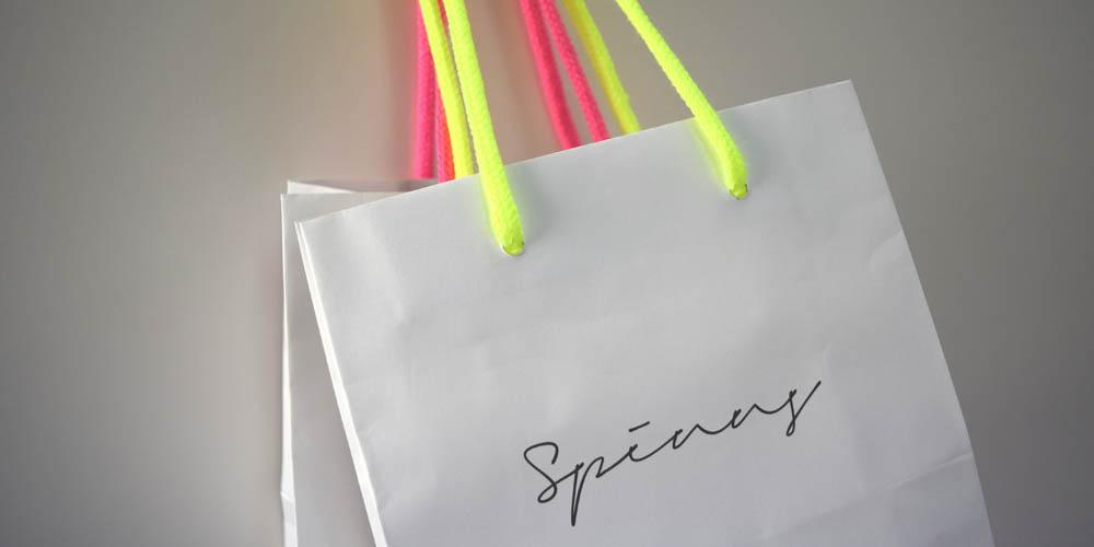 持ち手が蛍光色でおしゃれなアパレルショップ向けクラフト手提げ紙袋