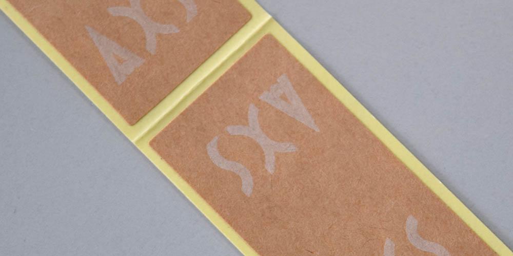 アパレルショップ様向けの商品封緘・包装用クラフト紙タックラベル(シール)