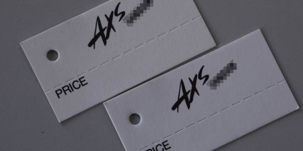 アパレルショップ様向けの商品への取り付け用穴開きタグ