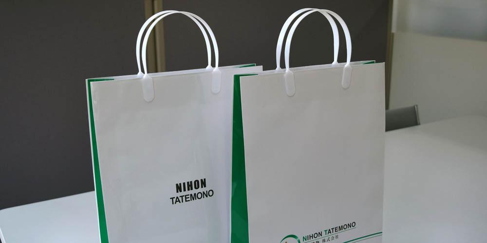 不動産コンサルティング会社で使用、資料配布や普段使いに便利な手提げ紙袋
