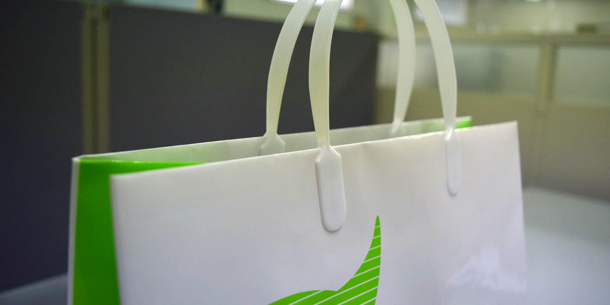 医療機器販売メーカー向け、営業資料配布用・イベント用手提紙袋(グロスPP)