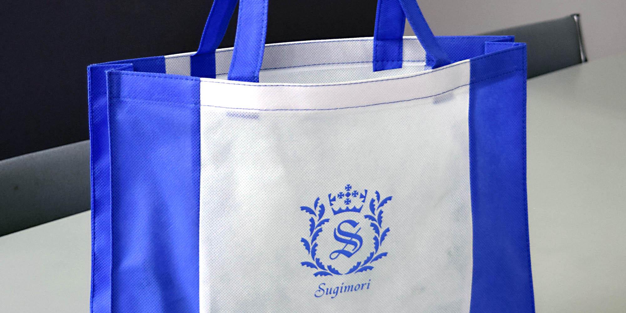 学校オープンスクールイベント用のオリジナル不織布角底バッグ。生地色切り返し(縦)あり